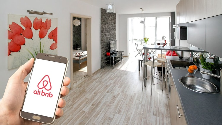 A traveler using Airbnb to book accommodation in their destination while traveling