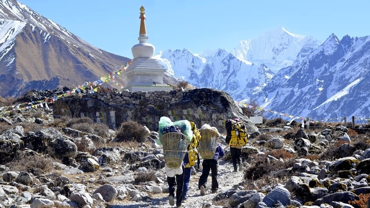 Budget travelers hiking on a mountain in Nepal which is one of the cheapest destinations in South Asia