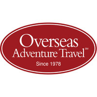 The logo for Overseas Adventure Travel which is a group tour company that provides small group tours for travelers older than 50 years of age