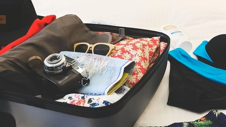 A suitcase full of clothes that a traveler has packed for their trip
