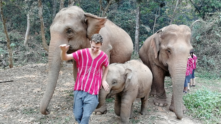 Sebastian playing with elephants in Chiang Mai, Thailand