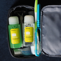 Travel-size toiletries in a traveler's toiletry bag designed to pass through airport security in a carry-on bag