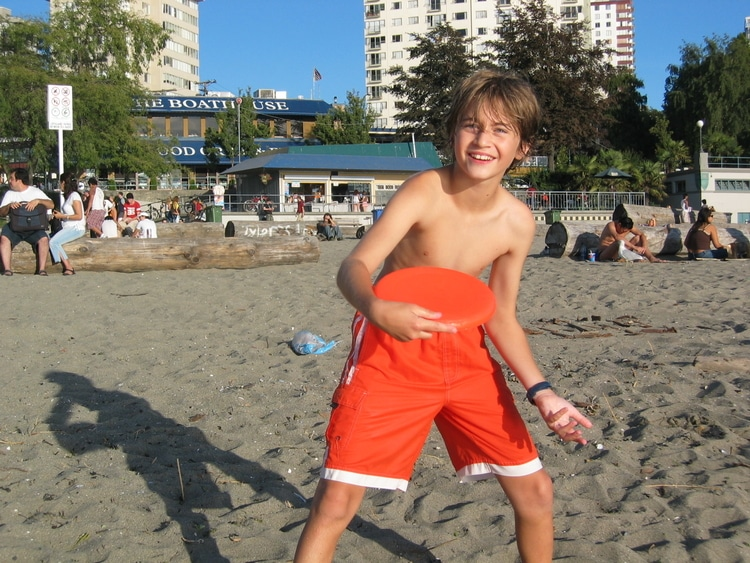 Sebastian from Travel Done Simple as seen on the beach in Vancouver Canada