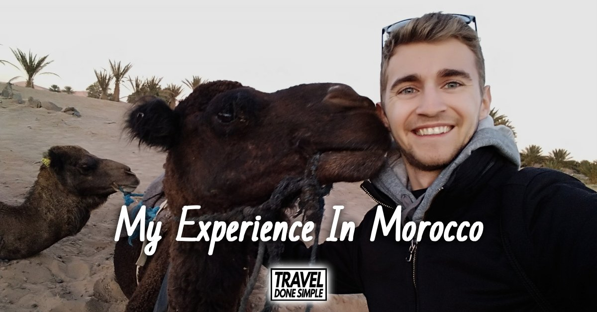 Sebastian from Travel Done Simple with a camel in the Sahara Desert in Morocco
